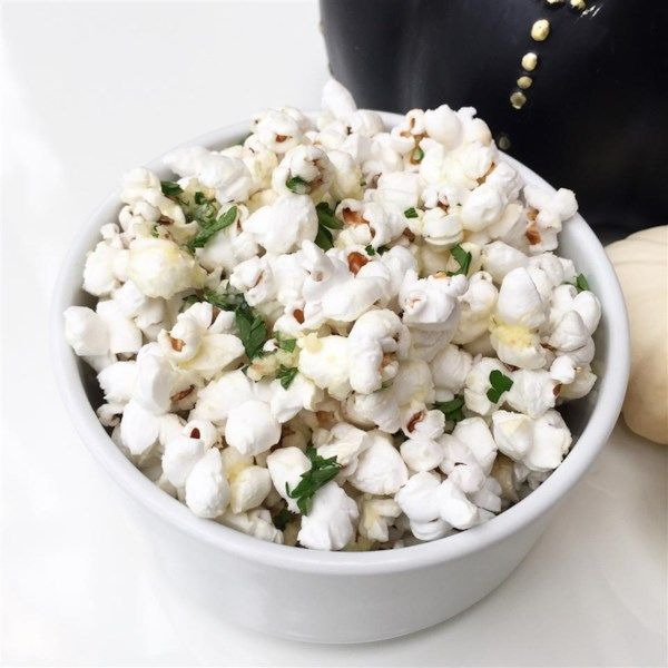 """Truffle Lovers' Popcorn   """"The flavors of truffle oil, parsley, and Parmesan cheese combine to create a whimsical gourmet appetizer or snack."""" #recipe #awardsshows #entertaining"""