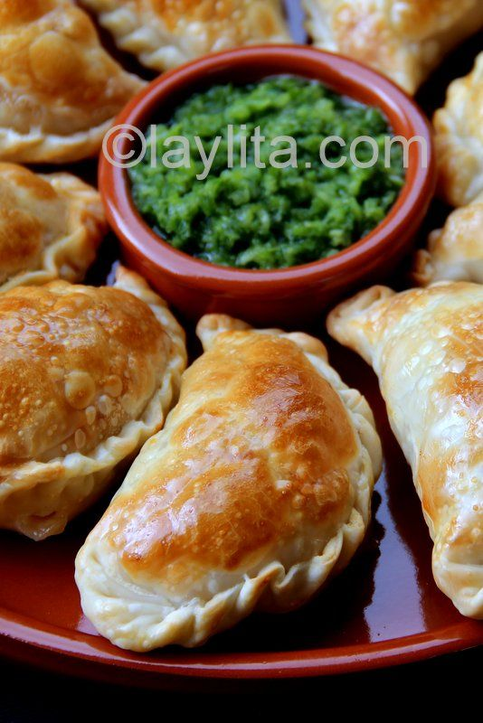 Mushroom and cheese empanadas with aji criollo cilantro sauce