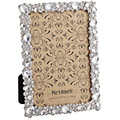Place a thin cork board sheet inside and now you have a chic reminder board to place in the bathroom, office, etc!