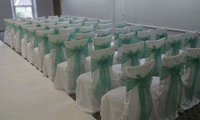 Jade Green Organza Bows on White Chair Covers