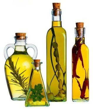 Excellent gourmet gift, easy to make at home! Olive oil flavored with oregano, thyme or just with garlic. Try on a salad!