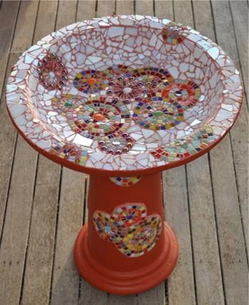 Bright mosaic birdbath. I like that it isn't a symmetrical design, makes for a more casual look.