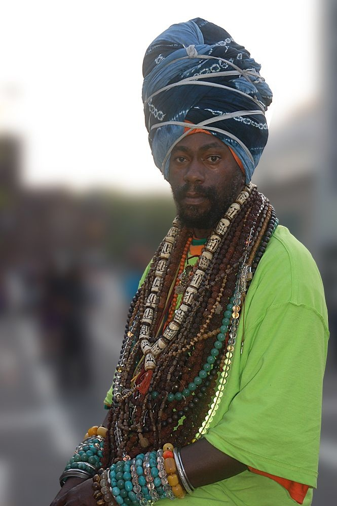 Colorful Rastafarian. Rastafari is a young, Africa-centred religion which developed in Jamaica in the 1930s, following the coronation of Haile Selassie I as King of Ethiopia in 1930.