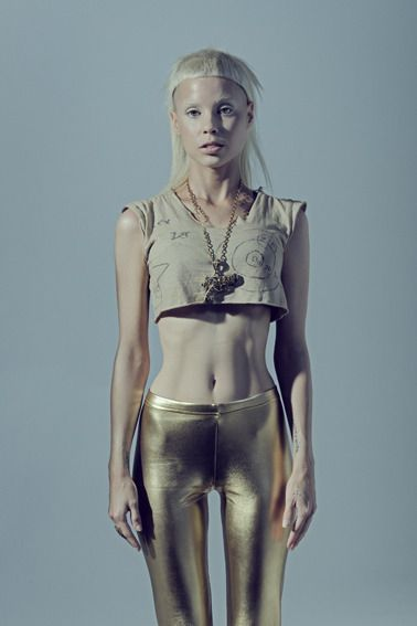 A little thinner than muscular but I love her body type. Die Antwoord gets me through my work outs
