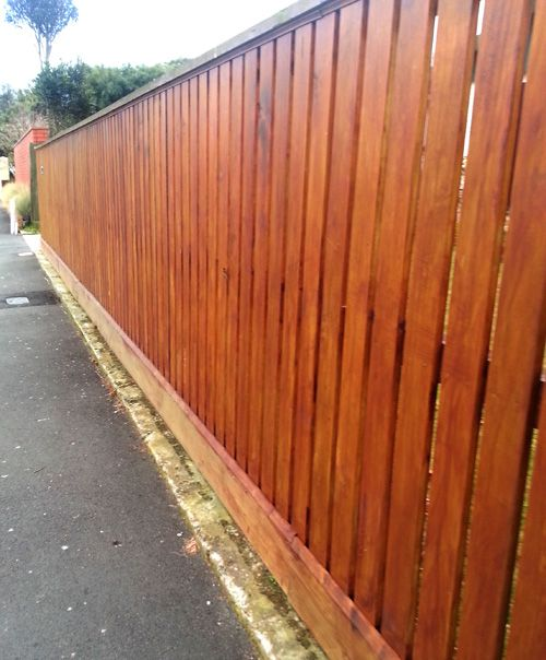 Nice staining job on this tall pailing fence.