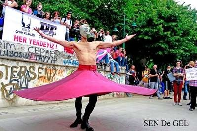 Turkish whirling dervish. The gas mask reflects tear gas used by police during the occup Gezi protest