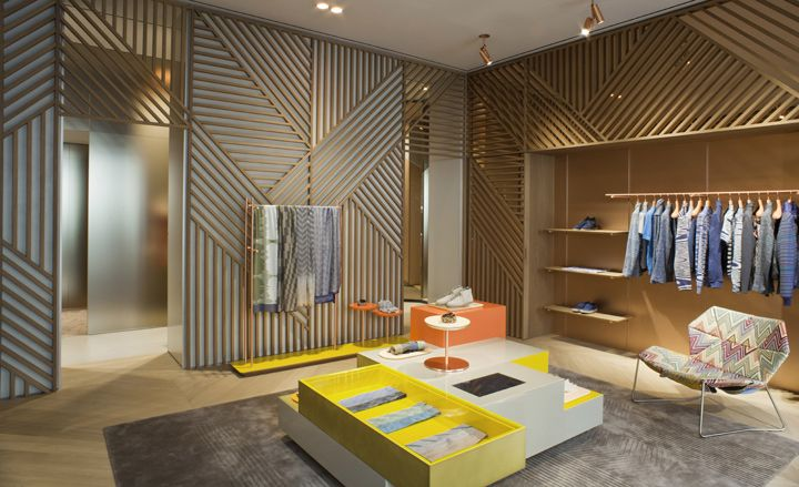 Patricia Urquiola has turned out to be the go-to architect for Milans high-end fashion labels. Missoni caught the fever, signing up the Spanish-born architect to remodel its Montenapoleone store. The new mood greets visitors at the front door, where clear orange glass doors slide open to reveal a subtle collage of signature Missoni motifs etched into wood, mirror and copper finish metal