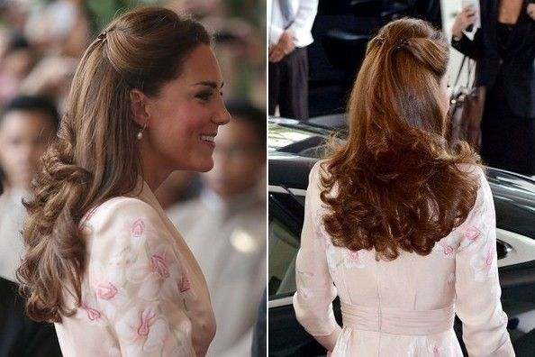 We never knew claw clips could look so sophisticated. The Duchess used a pair to fasten two thick sections of hair at the top of her crown, leaving the rest of her mane flowing into flipped out, curled ends.