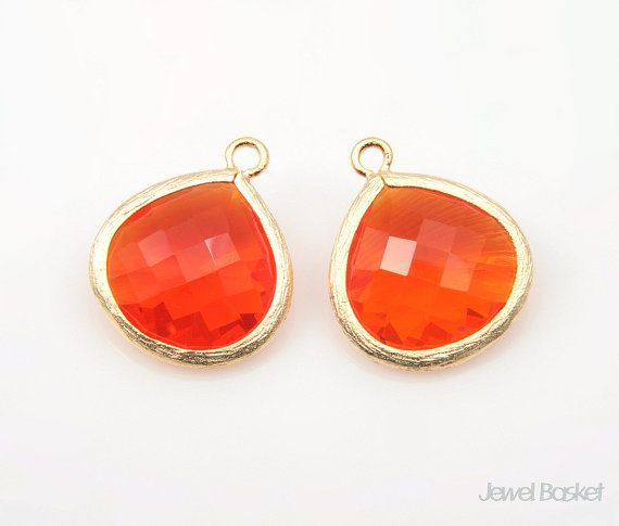 These charming matte gold framed Carnelian color glass pendants will be perfect for necklaces, earrings and bracelets. This listing is for 2 pieces of Carnelian color glass pendants beads. They have a nice sized hole for your own designs. They are made of brass, Carnelian color glass and are plated matte gold.  - High Matte Gold Plated over Brass Frame (Tarnish Resistant) - Carnelian Color Glass - Brass and Glass / 15mm x 18mm - 2pcs / 1pack