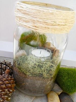 Canning jar + dirt + moss + river rocks + tea light = Fun lighting for tents or tables!