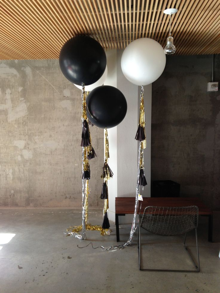 Black And White Geronimo Ballons With Streamers Flanking