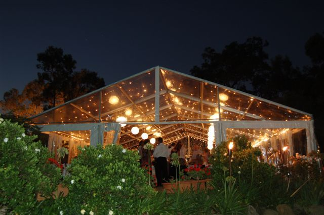 Clear roof marquee - perfext for a garden wedding where the weather is being uncooperative. Not for summer though - would be more like a glass house, hot and humid