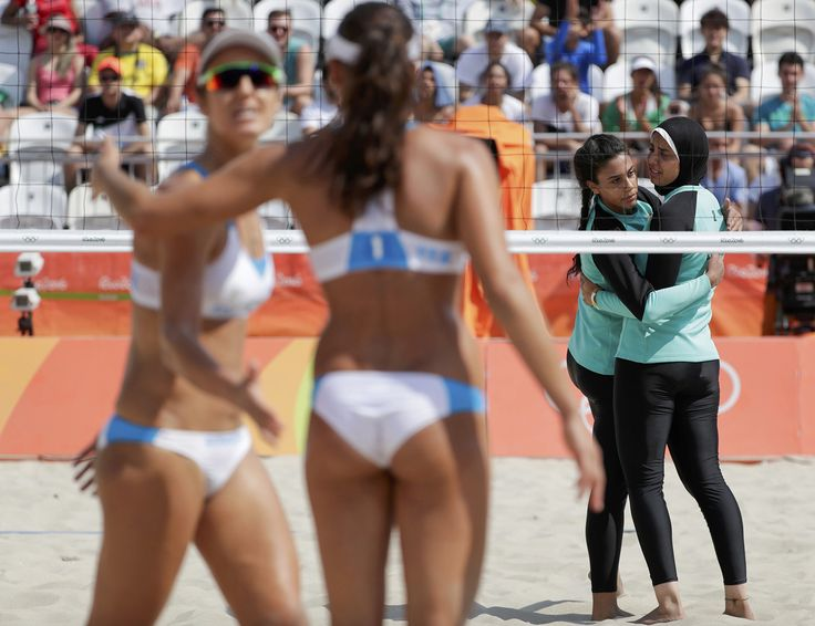 Italy's Laura Giombini and Marta Menegatti (near side) face off against Egypt's Doaa Elghobashy and Nada Meawad of Egypt in a Women's Beach Volleyball Preliminary match on August 9, 2016. #