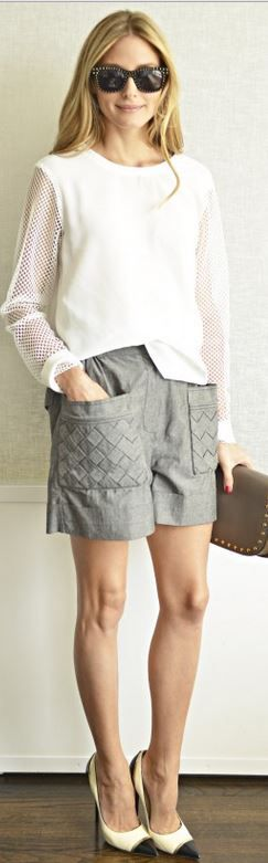 Who made  Olivia Palermo's gray shorts, black sunglasses, brown studded clutch handbag, white top, and cap toe pumps
