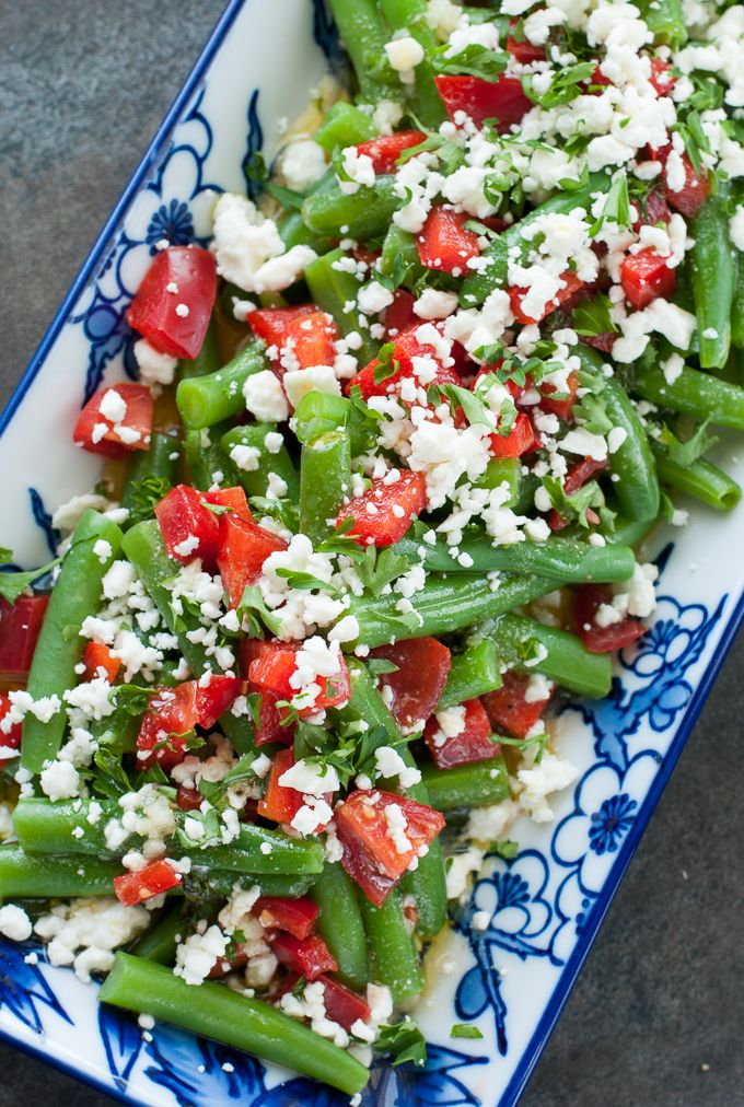 This Greek Green Bean Salad is fresh, flavorful, and ridiculously easy to make! As a tasty bonus, these gorgeous green beans are ready in just 15 minutes!