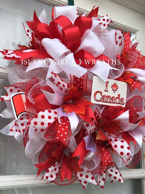 This Canadian deco mesh wreath is made on a white work wreath form using a 21 wide white deco mesh as the base and is layered with ruffles made from 10 wide red deco mesh and some 10 wide white deco mesh. Its embellished with 4 different styles of red and white wired ribbons.