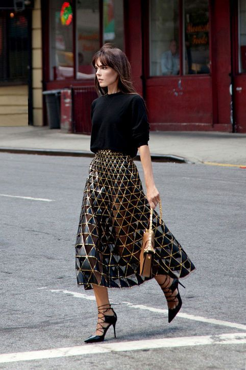 Pair your black sweater with a metallic, geometric skirt. Beautiful.
