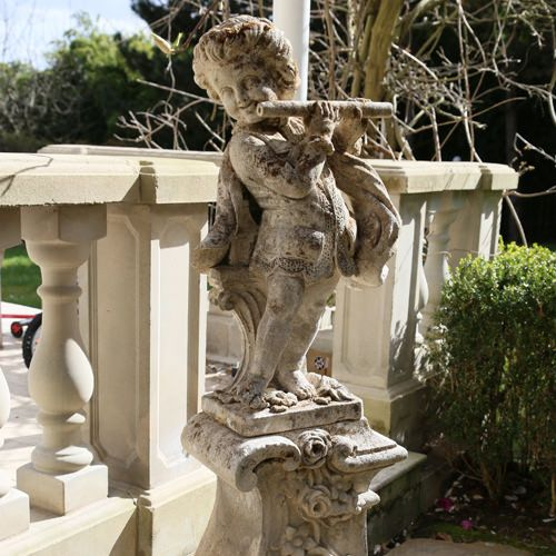 "GARDEN SCULPTURE  Epoque : 1890 Dimensions : H. 157cm. L. 42cm. P. 26cm.   ""Child with flute"" Late 19th century garden sculpture made of Burgundy stone representing a child dressed in 18th century style and playing the flute. The child stands on a pedestal of acanthus leaves. In perfect condition."