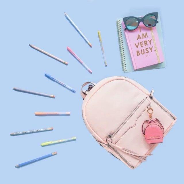Of course we accessorize our desk!  Pens, Pencils, and Notebooks: #Bando Bag: #RebeccaMinkoff Bag Charm: #MichaelKors Sunglasses: #LeSpecs