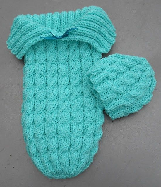 Free knitting pattern on Cozy in Cables Sleep Sack and matching hat - Designed by Suzetta of Suzie's Stuff. snuggle baby bunting bag cocoon