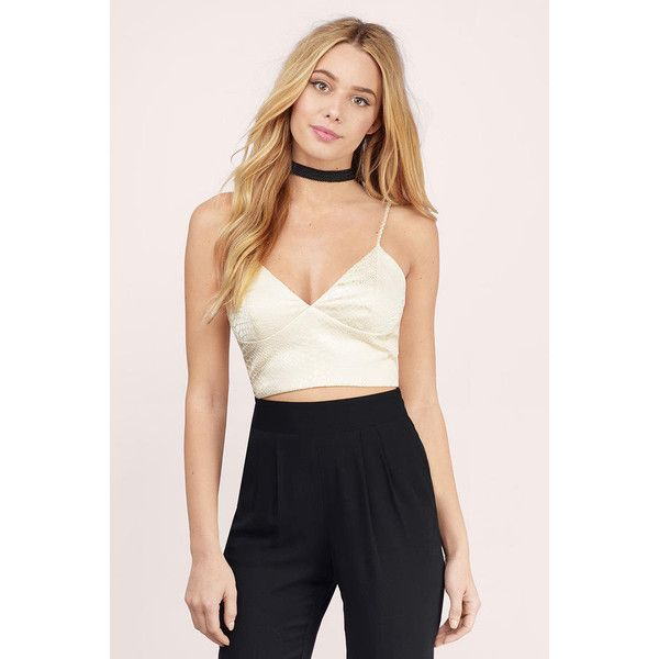 Tobi Shed Your Skin Crop Top ($36) ❤ liked on Polyvore featuring tops, cream, strappy crop top, cut-out crop tops, snakeskin crop top, strappy top and spaghetti-strap top
