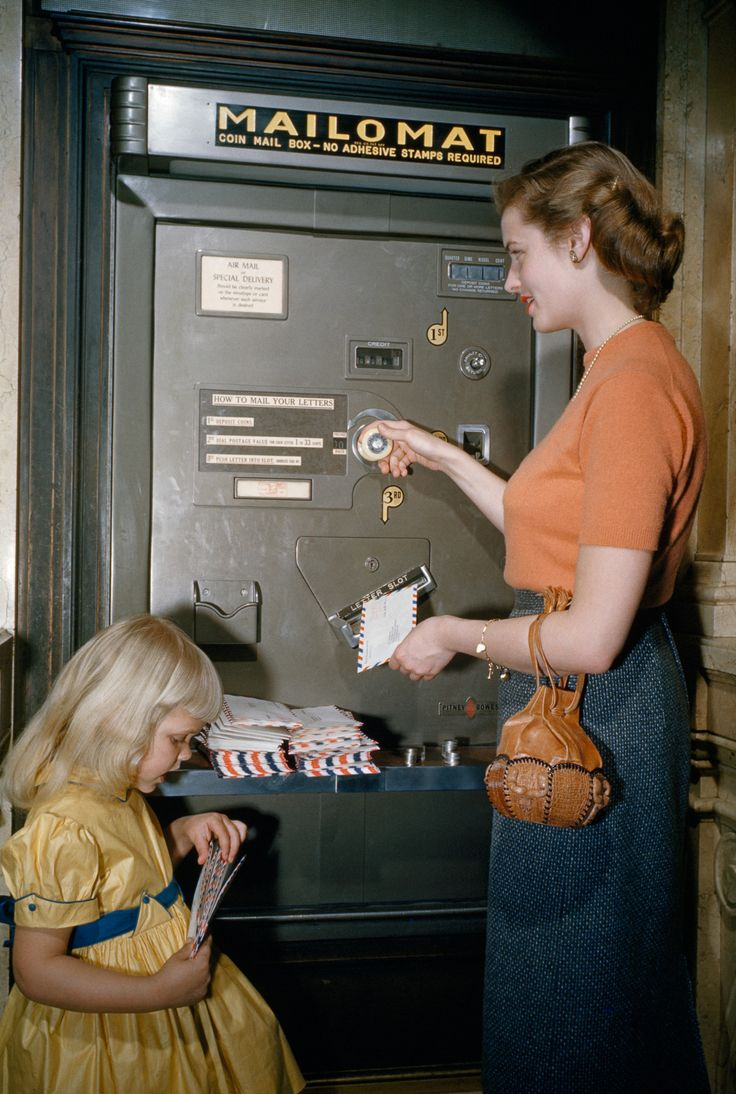 Picture of A woman and child mail letters at a robotic post office