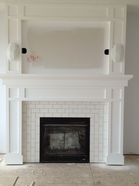 Subway tile in a bright colour w/ a painted moulding mantel.