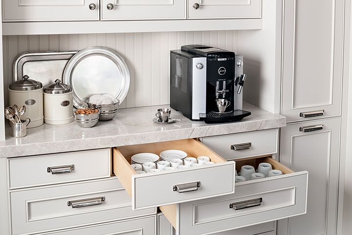 The countertop provides enough space to store serving trays, coffee beans and sugar. The lower drawers provide storage for espresso and coffee cups.  Additional drawers can be used to store tea, hot chocloate and sweeteners.