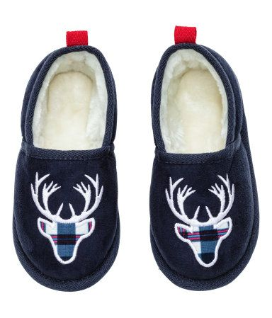 Dark blue. Slippers in imitation suede with embroidery at top. Faux fur linings and insoles. Soft, imitation suede soles with non-slip protection.