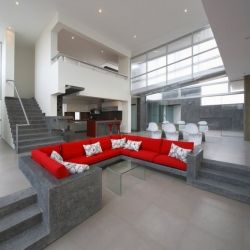 Ultra modern bachelor pad with concrete built in furniture.  Could use some ideas for a great living space.