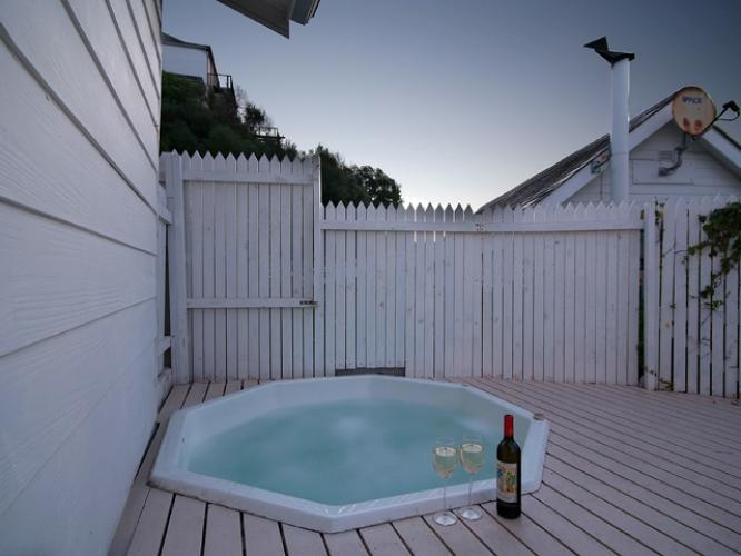 Toast the sunset in your private jacuzzi at 62 on Fourth, Clifton.