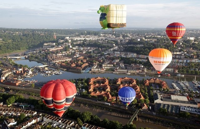 Hot air balloons take to the skies over Bristol city centre.