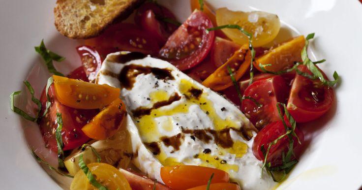 2 (8- to 10-ounce) balls of fresh burrata cheese 16 to 20 (2-inch diameter) heirloom tomatoes Good olive oil Aged balsamic vinegar Kosher salt and freshly…