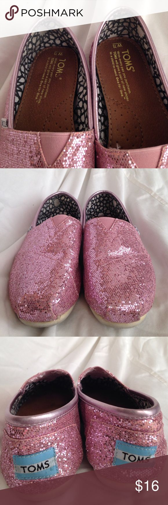 Sparkly Pink Toms These sparkly pink Toms are a size 7.5 and have been worn only a handful of times. Some sparkle bald spots on back of shoes and front as you can see in the pictures. Inside shows barely any wear, lots of life left! Toms Shoes Flats & Loafers