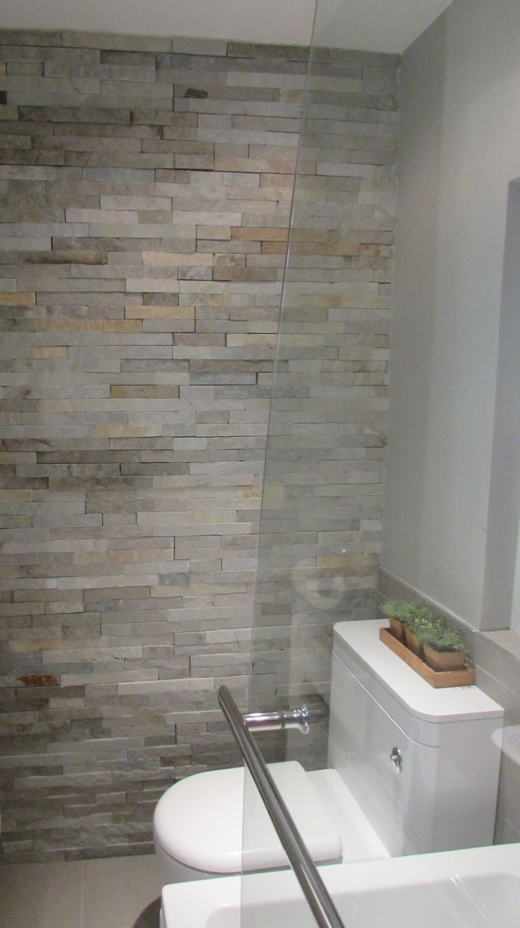 Hotel Style Bathrooms Split face tiles add texture and interest to this small city bathroom