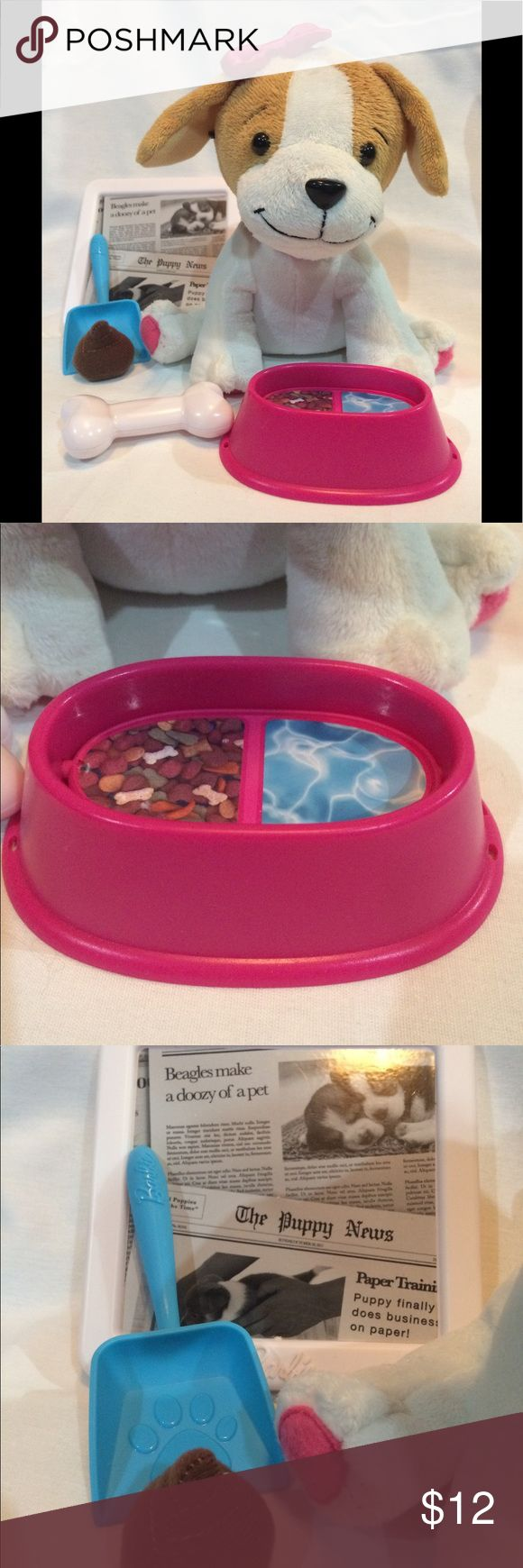 "Barbie Training Puppy Potty Time Interactive puppy responds to newspaper training pad. Pet puppy to activate different adorable puppy sounds. Food/Water dish flips from ""full"" to ""empty"" Accessories include bone, food and water dish, newspaper training pad, pretend poo and pooper scooper. Barbie Other"