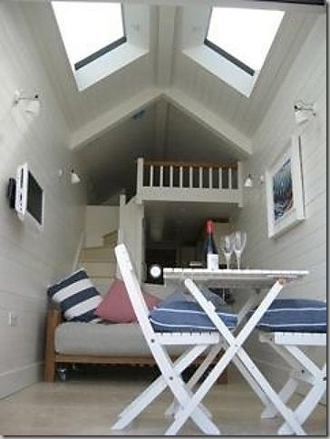 Loft bed in skylighted tiny house