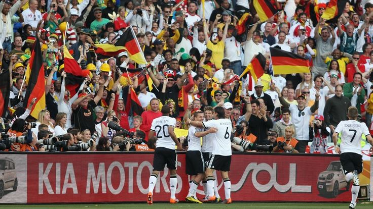 BLOEMFONTEIN, SOUTH AFRICA - JUNE 27: Lukas Podolski of Germany is congratulated by team mates after scoring the second goal for his team during the 2010 FIFA World Cup South Africa Round of Sixteen match between Germany and England at Free State Stadium on June 27, 2010 in Bloemfontein, South Africa. (Photo by Joern Pollex/Getty Images)