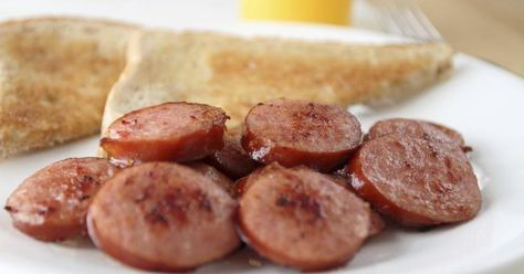 Kielbasa, or Polish sausage, is a mixture of ground meat and spices secured in hog casings that is cured and smoked. The sausage's key ingredients include pork, beef, garlic and marjoram spice. Cooking a kielbasa ring can be done in a number of ways, depending on your preference. For those with time restraints, a slow-cooker recipe may work, but...