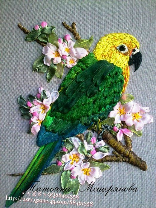 Green parrot in silk ribbon