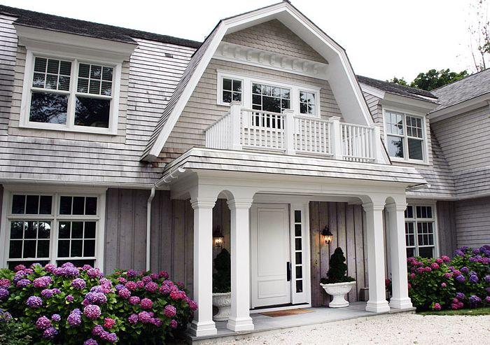 Elsa Soyars - home exteriors - gray siding, gray home exterior,  Beautiful home exterior with crisp white columns, second story balcony, gray