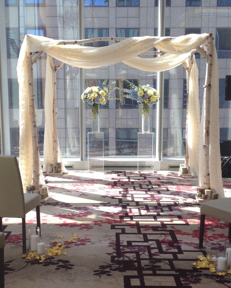 Birch chuppah with soft off-white drapes @Shangri-La Hotel Toronto by www.chuppah.ca