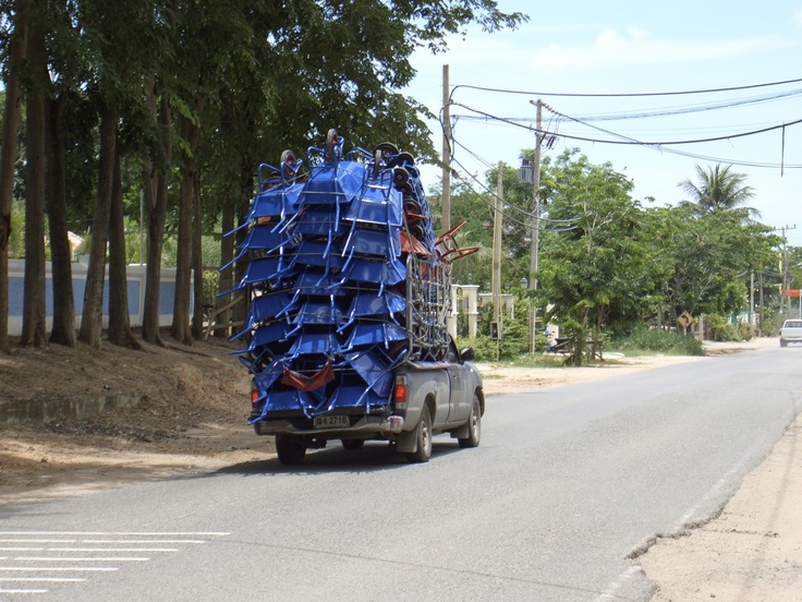 A pickup truck overloaded with wheelbarrows, East Pattaya.