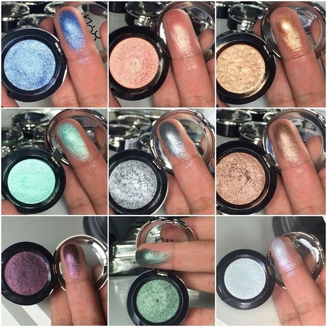 swatches of some of NYX's new Prismatic Single Eyeshadows! Colors shown are Blue Jeans, Golden Peach, Liquid Gold, Bedroom Eyes, Mermaid, Smoke & Mirrors, Jaded, Punk Heart, & Frostbite