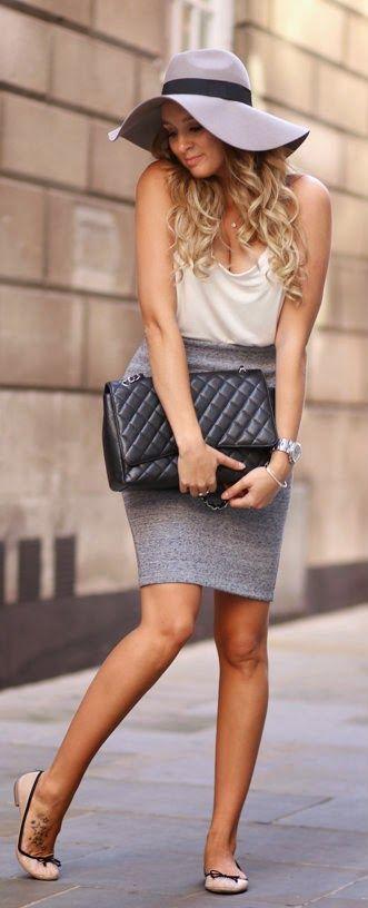 A Cute Way To Show Fashion at work. Gray skirt, hat. Black handbag. Summer clothing