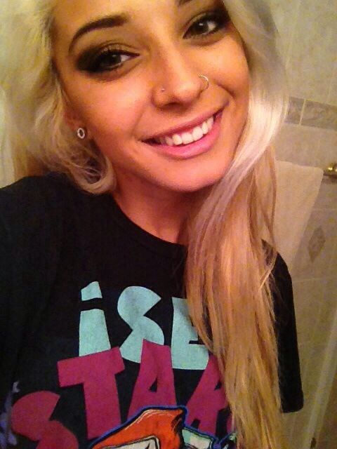 Double nose piercing? not sure. either double on one side or one on each. OR ring and a septum ?