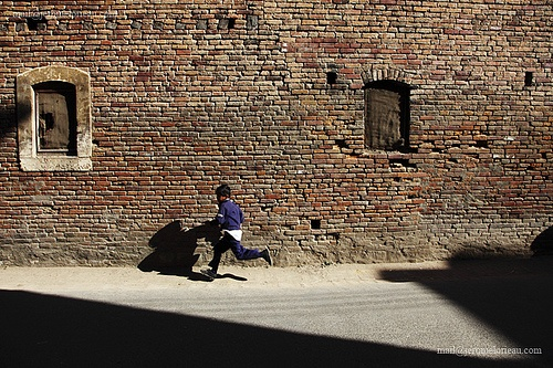 A school boy is running around Pyaphal, Kathmandu