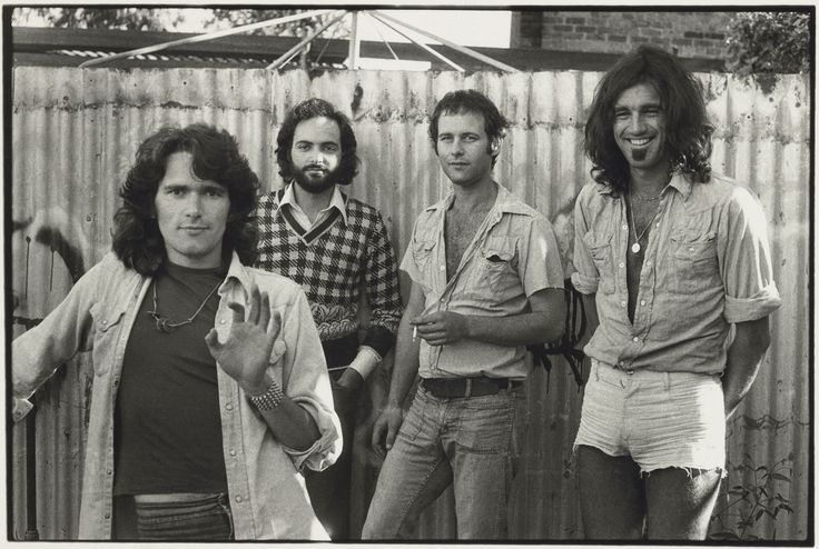 Carol Jerrems Outback Press Melbourne 1974 left to right: Colin Talbot (writer), Alfred Milgrom (publisher), Morry Schwartz (entrepreneur, publisher, now publisher of The Monthly), Mark Gillespie (singer/songwriter) Gelatin silver photograph National Gallery of Australia, Canberra