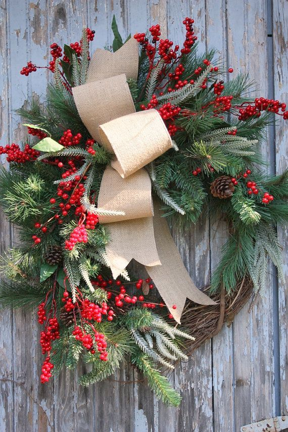 Christmas Wreath, Burlap, Pine, Red Berries I would add some deer antlers where the white skinny flowers are.....
