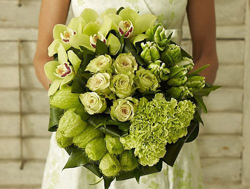 """We pinned this to show how Gomphocarpus physocarpus (aka """"hairy balls""""--shown at bottom-left of bouquet) can be a great addition to a bouquet....(otherwise this photo features a lot of out of season or imported flowers)"""